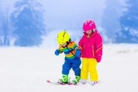 bigstock-Two-Children-Skiing-In-Snowy-M-109782728