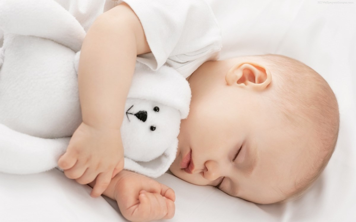 Adorable-Sleeping-Baby-With-Toy-Images