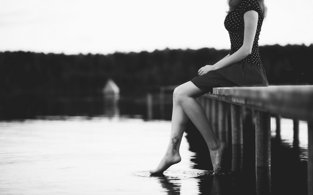 Sad-girl-foot-in-water-black-and-white